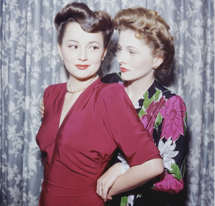 Olivia de Havilland (left) with Joan Fontaine, her sister, circa 1945.