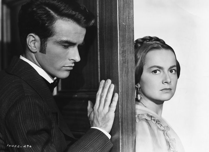 "Olivia de Havilland with Montgomery Clift in the 1949 film ""The Heiress,"" for which she won her second Best Actress Oscar."