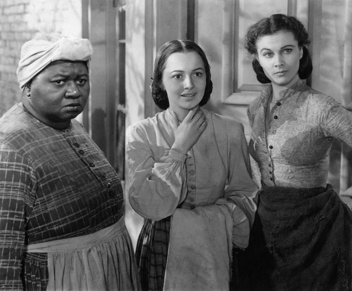 "Olivia de Havilland (center), with Hattie McDaniel and Vivien Leigh, in a scene from ""Gone with the Wind."""
