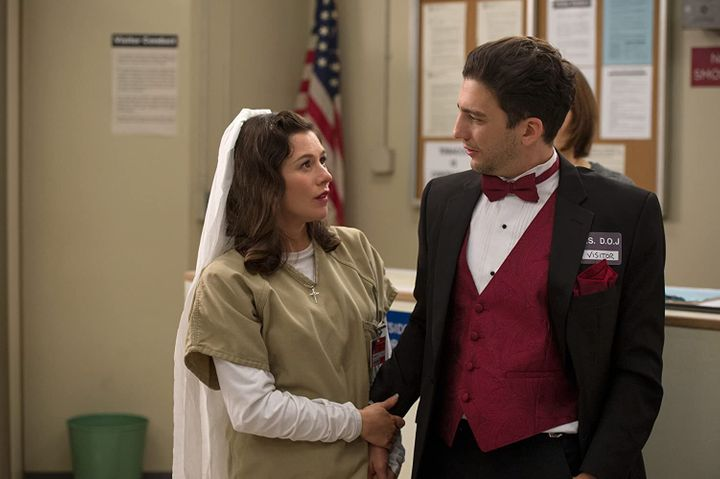 """Magaro with Yael Stone in an episode of """"Orange Is the New Black."""" He appeared in 11 episodes of the popular Netflix series."""