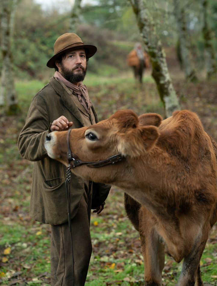"""Eve the cow (seen here with John Magaro) makes her screen debut in """"First Cow."""""""