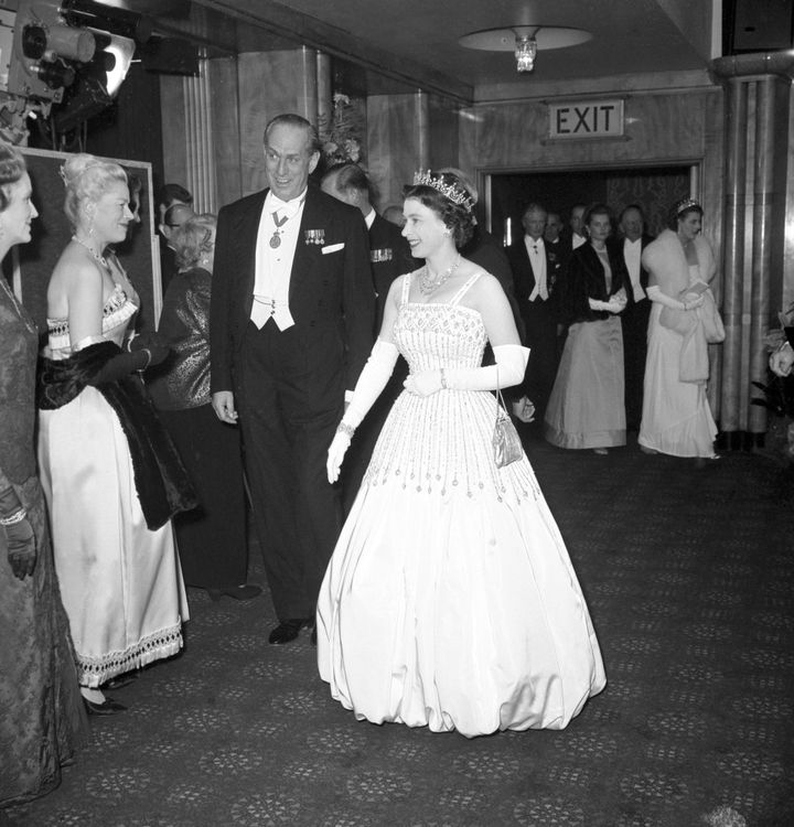 """Queen Elizabeth wearing the original dress in 1962 at the premiere of """"Lawrence of Arabia."""" Princess Beatrice wore an updated"""