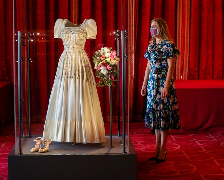 Princess Beatrice poses alongside her wedding dress as it goes on display at Windsor Castle on Sep. 23, 2020 in Windsor, Engl