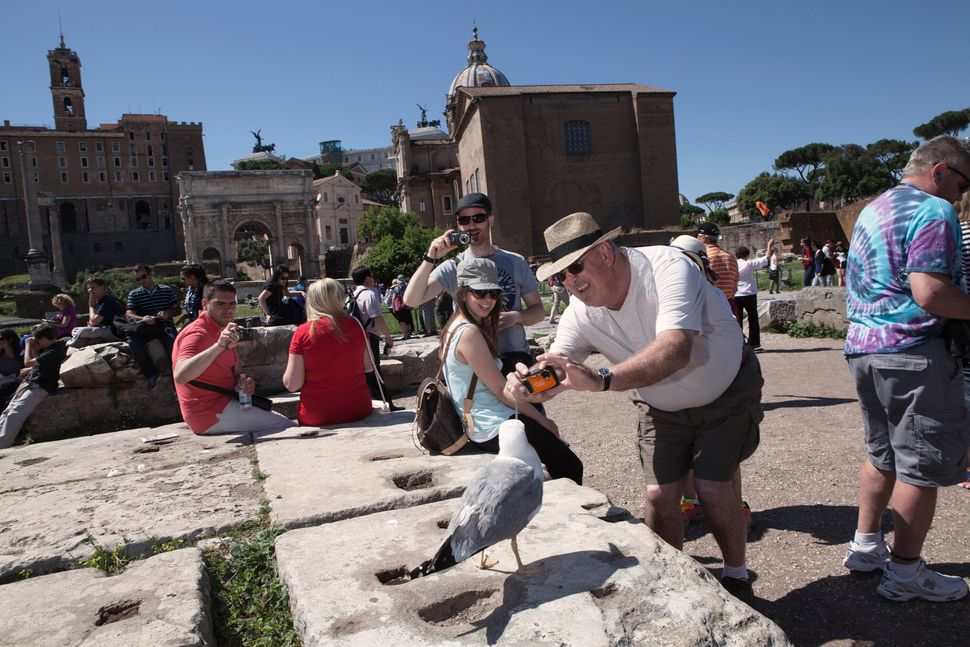 According to the Italian Ministry of Cultural Heritage and Activities, in 2019, more than 55 million tourists visited museums and archeological sites in Rome, such as the Roman Forum, pictured here. Access to the site has been restricted to reservation-only. Above: May 29, 2015| Below: July 31, 2020