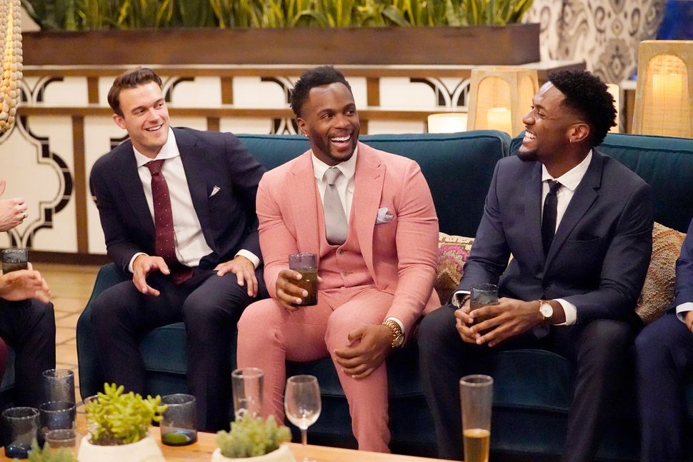 """Nwachukwu (center) with castmates Ben Smith (left) and Demar Jackson (right) on this season of """"The Bachelorette."""""""