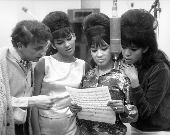 Phil Spector looked at sheet music with hit trio The Ronettesat Gold Star Studios in 1963.