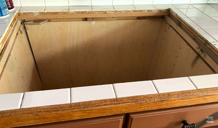 A hole in the kitchen where the stove should be.