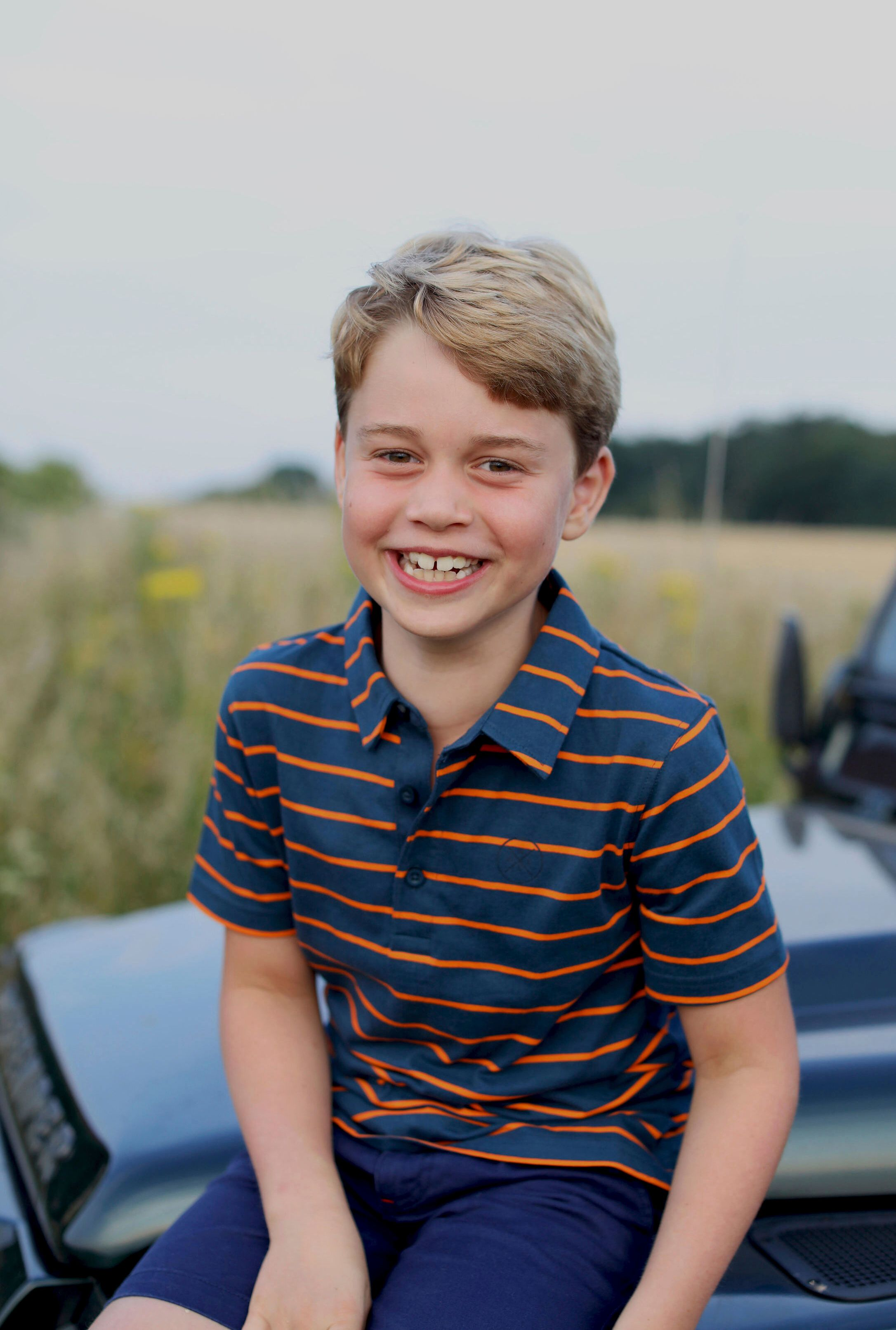 This July 2021 photo issued by Kensington Palace on July 21 shows Prince George in Norfolk, England, in a photo taken by his