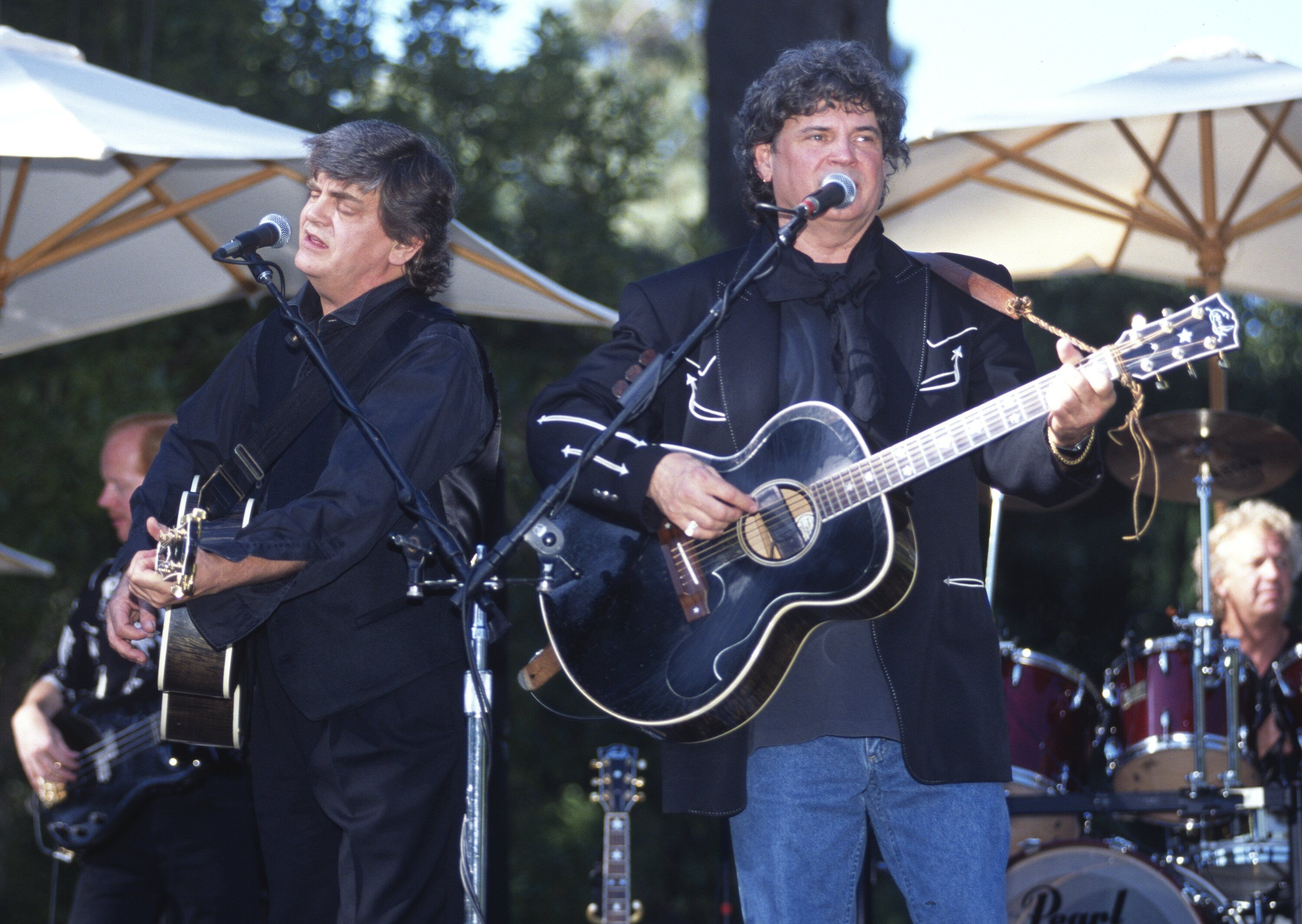 Phil Everly, left, and Don Everly of the Everly Brothers perform at Villa Montalvo on July 30, 1995 in Saratoga, California.