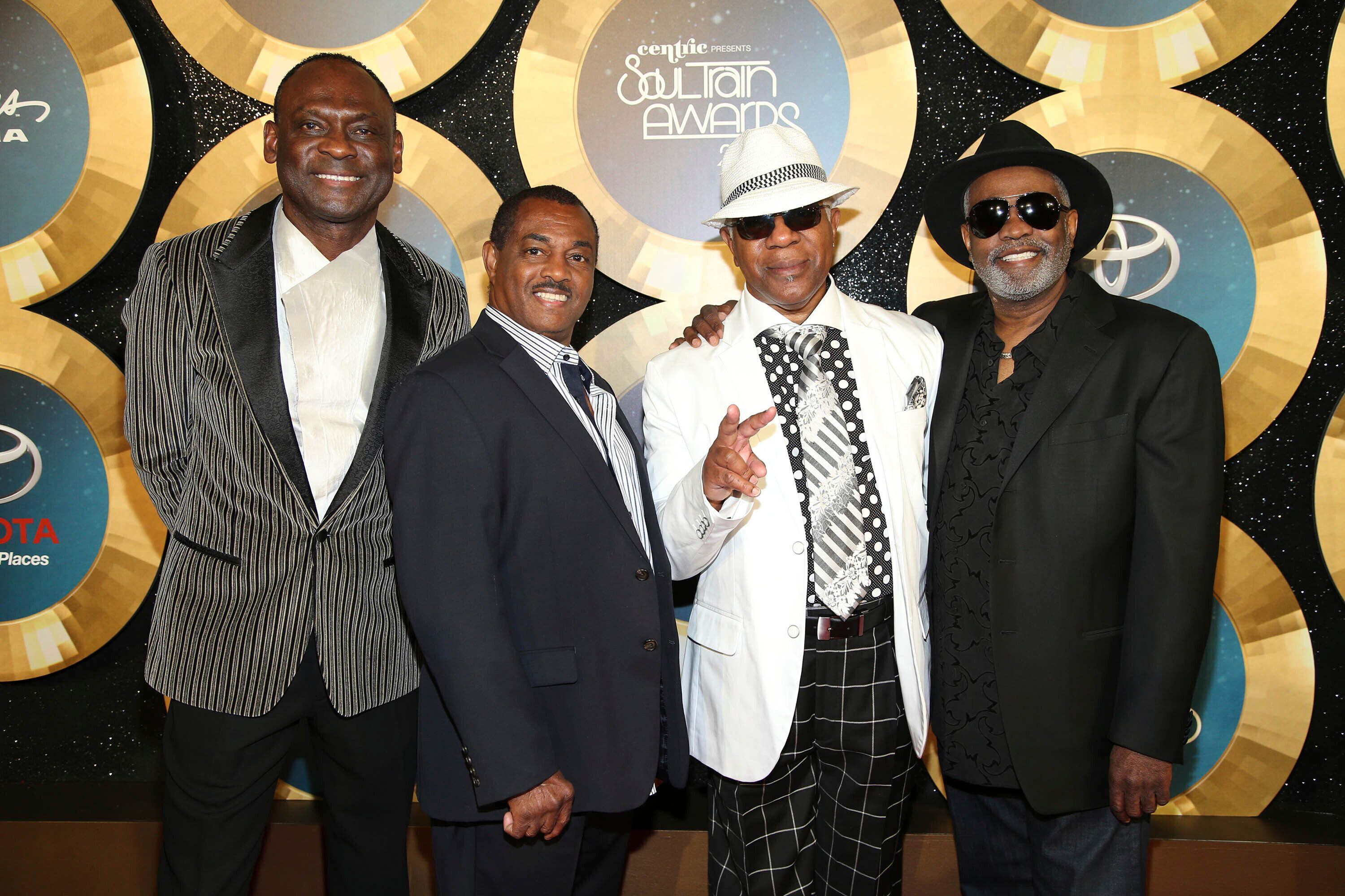 In this Nov. 7, 2014 file photo, George Brown, Ronald Bell, Dennis Thomas and Robert 'Kool' Bell of Kool and the Gang arrive